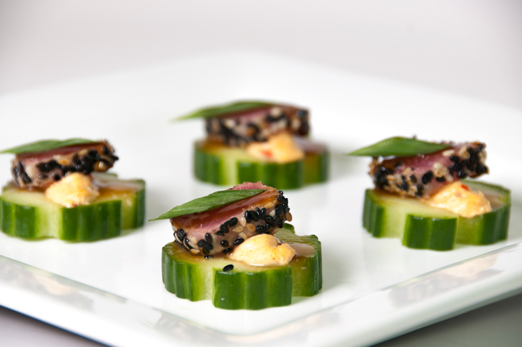 Plated tuna tartare on cucumber slices